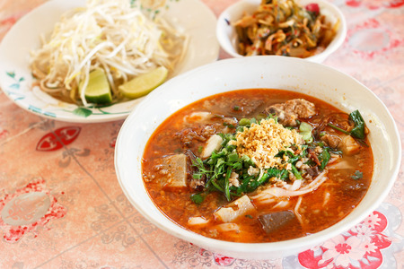 tangy: Rice noodles with spicy pork sauce Nam ngiao is a noodle soup or curry of the cuisine of the Tai Yai people. Nam ngiao has a characteristic spicy and tangy flavor. thai food.
