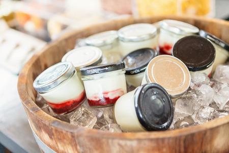 Homemade frozen yogurt in Wooden oak barrel. Stock Photo