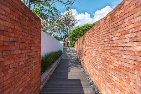 wooded path: Wooden walkway between the wall.