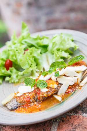chilli sauce: Thai food style : Fried fish toppted with chilli sauce. Stock Photo