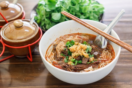 asian noodles: Rice noodles with spicy pork sauce Nam ngiao is a noodle soup or curry of the cuisine of the Tai Yai people. Nam ngiao has a characteristic spicy and tangy flavor. thai food.