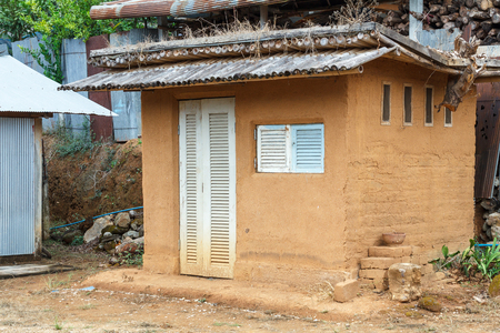 fibrous: Cob house in Northern Thailand. The house is a natural building material made from subsoil, water and some kind of fibrous organic material.