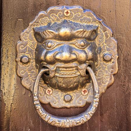 door handle: Old metal ornamental brass door handle close-up. Stock Photo