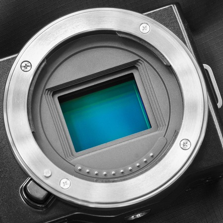cmos: Digital camera sensorAPS-C CMOS sensor on a digital mirrorless camera.