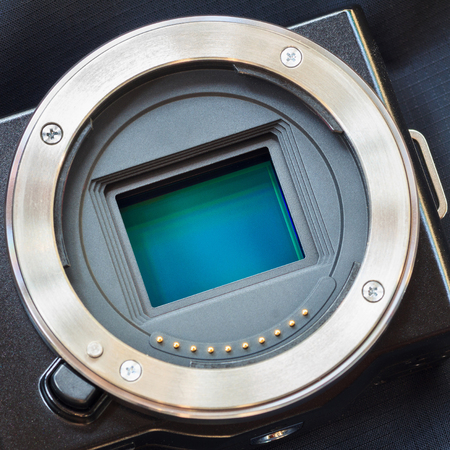 Digital camera sensorAPS-C CMOS sensor on a digital mirrorless camera.