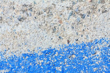 stain: Cement wall with stain of blue oil color, cement texture background for design.