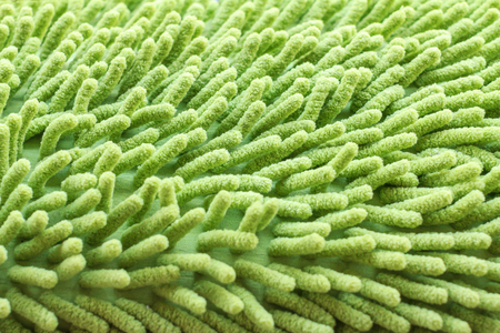 carpet clean: Doormat for clean and wipe foot. Background texture of green carpet or mat. Colseup of doormat.