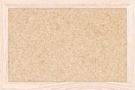 Empty bulletin board with a wooden frame, cork board texture, blank corkboard.