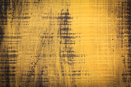 fissures: Abstract background texture of Nature wood background is painted in yellow gold oil color paint for background and design with copy space for text or image. Dark edged.