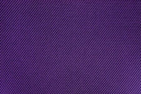 texture cloth: Purple and violet fishnet cloth material as a texture background. Purple and violet nylon texture for background with copy space for text or image.