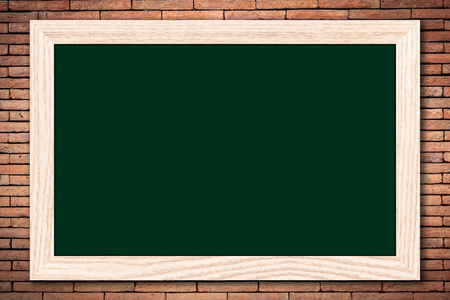 Chalkboard or Empty bulletin board with a wooden frame on brick wall background for design with copy space for text or image.