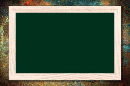 Chalkboard or Empty bulletin board with a wooden frame on rusty metal background with copy space for text or image. Stock Photo