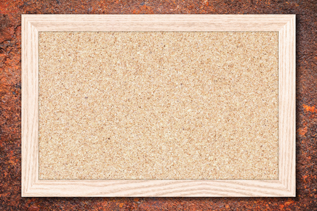 bulletins: Cork board or Empty bulletin board with a wooden frame on rusty metal background with copy space for text or image. Stock Photo