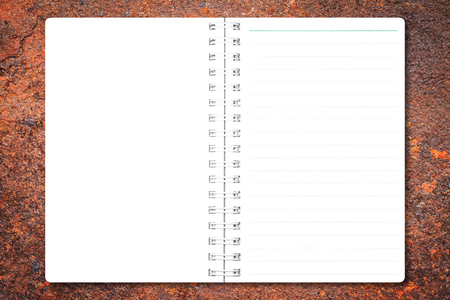Open notebook paper empty page with green line on rusty metal background for design with copy space for text or image.