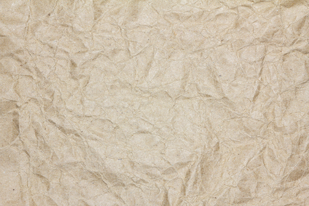 Recycled crumpled brown paper texture or paper background for design with copy space for text or image. Archivio Fotografico