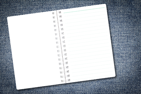 Open notebook paper page with line on denim jeans background for design with copy space for text or image.