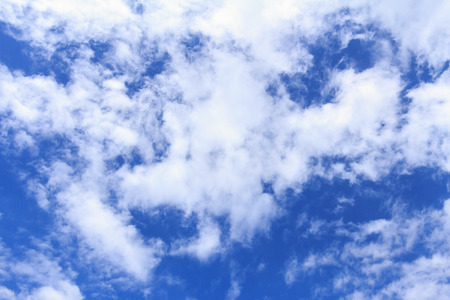 Blue sky background with white clouds. The vast blue sky and clouds sky on sunny day. White fluffy clouds in the blue sky. Reklamní fotografie