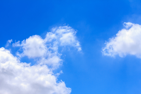 Blue sky background with white clouds. The vast blue sky and clouds sky on sunny day. White fluffy clouds in the blue sky. Stock Photo