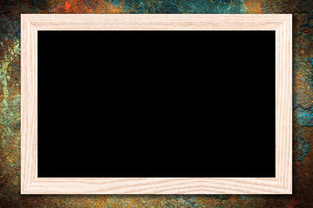Blackboard or Empty bulletin board with a wooden frame on rusty metal background with copy space for text or image. Stock Photo