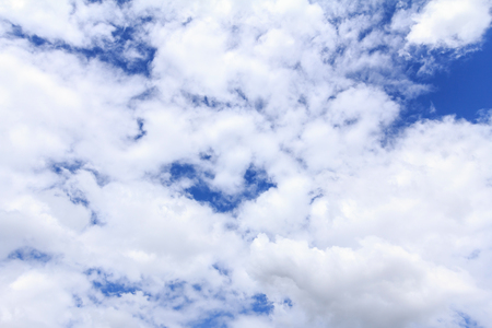 Blue sky background with white clouds. The vast blue sky and clouds sky on sunny day. White fluffy clouds in the blue sky. 写真素材