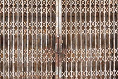 rolling garage door: Old steel door texture pattern or steel door background with rusty metal. Grunge retro vintage of steel door for design.