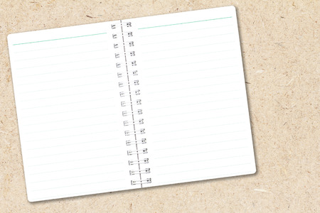 Open notebook paper page with line on chipboard background for design with copy space for text or image. Stock Photo