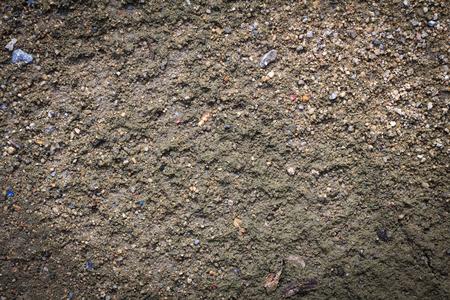 Soil texture or soil background for design. Dark edged.