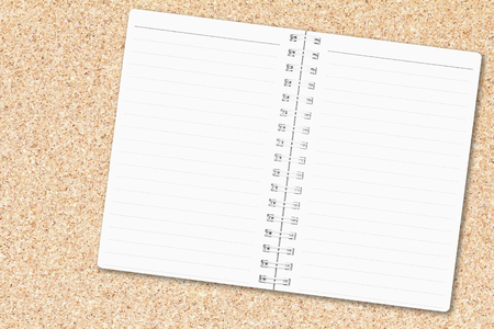 Open notebook paper page with line on cork board background for design with copy space for text or image. Stock Photo