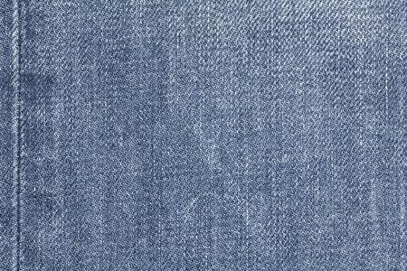 Denim jeans texture, denim jeans background with seam. Old grunge vintage denim jeans. Stitched texture denim jeans background of jeans fashion design.