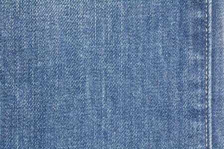 Denim jeans texture or denim jeans background with seam. Old grunge vintage denim jeans. Stitched texture denim jeans background of jeans fashion design.