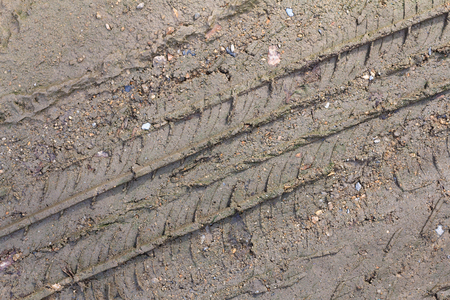 Wheel track on the soil. Track wheel on the ground.