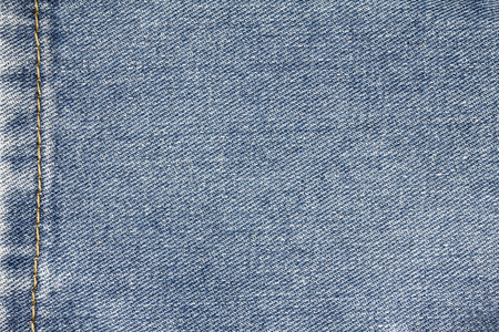 Denim jeans texture, denim jeans background with seam of jeans fashion design.