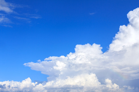Blue sky background with white clouds. The vast blue sky and clouds sky on sunny day. White fluffy clouds in the blue sky. Фото со стока