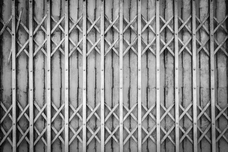 rolling garage door: Old steel door texture, old steel door background with rusty metal. Grunge retro vintage of steel door for design. Black and white. Dark edged.