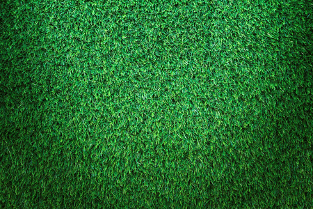 Green grass texture, green grass background. Top view of artificial green grass for golf course and soccer field.