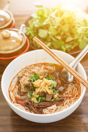 popular soup: Rice noodles with spicy pork sauce (Nam ngiao) is a noodle soup or curry of the cuisine of the Tai Yai people. Nam ngiao has a characteristic spicy and tangy flavor. thai food.