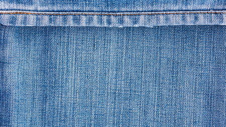 grid: Denim jeans texture, denim jeans background with seam for beauty, fashion and clothing concept design. Stock Photo