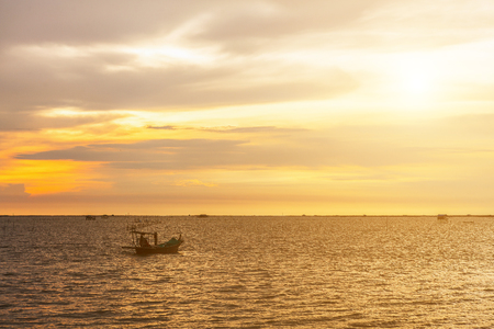 trawler net: Fishing boat on the sea at sunset for travel or fishery concept design.