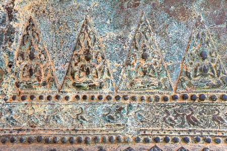 low relief: Low relief art on metal, Thai style handcraft of thai temple for background and design. Thai art.