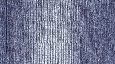 Denim jeans fabric texture background with seam for beauty, fashion and clothing concept design. 写真素材