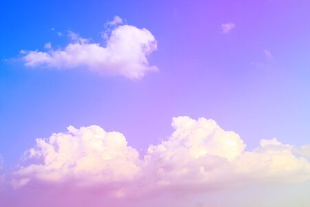 Blue sky background with white clouds, rain clouds on sunny summer or spring day. Color effect picture. Stock Photo