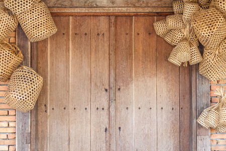Wooden door and brick wall background with basket weave wood for interior design business  exterior decoration and industrial construction idea concept. Vintage style effect picture. Stock Photo