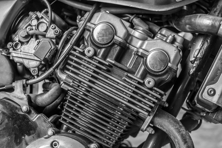 twin engine: Detail of motorcycle engine for transportation or technology concept design. Black and white. Stock Photo