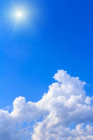 Blue sky background with white clouds rain clouds and sunshine on sunny summer or spring day.
