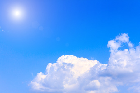 Blue sky with white clouds. rain clouds and sunshine on sunny summer or spring day.