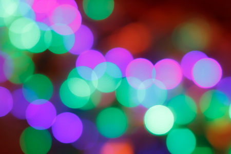 Colorful abstract blurred circular bokeh light of night city street for background. graphic design and website template idea concept design.
