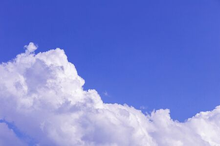 Blue sky and white clouds, rain clouds on sunny summer or spring day. Imagens