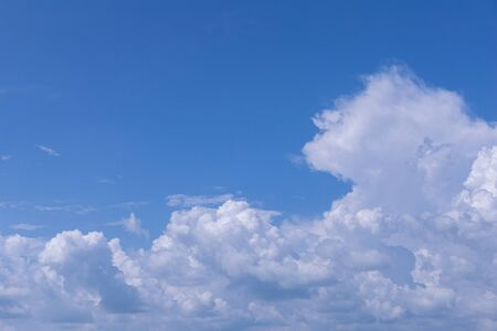 Blue sky background with white clouds on sunny day. Stock Photo