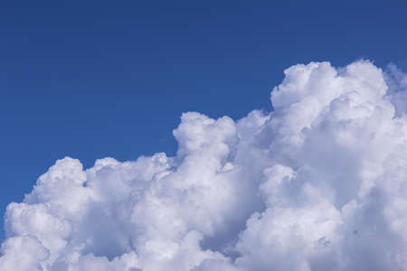 Blue sky background with white clouds on sunny day.