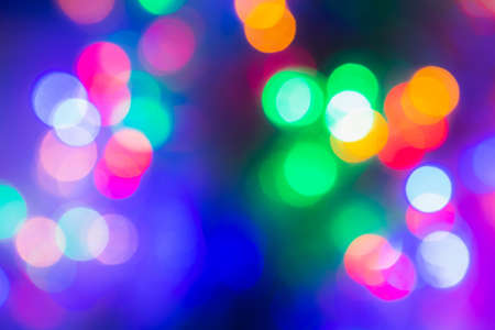 Colorful bokeh background. Christmas or New Year holiday card template.